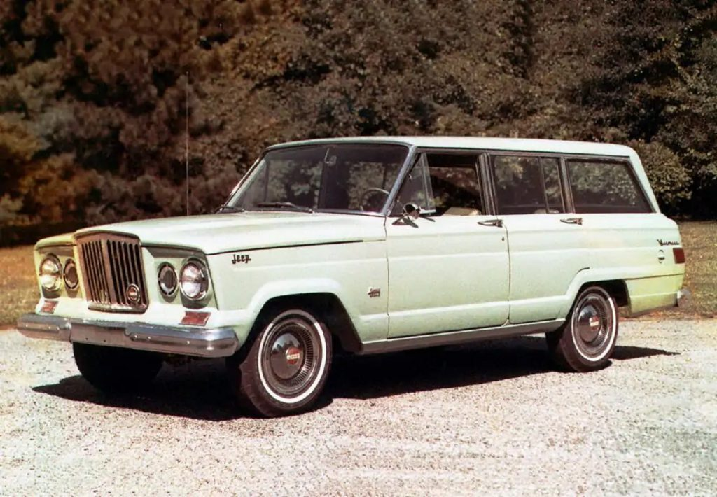 A pale-green 1963 Jeep Wagoneer
