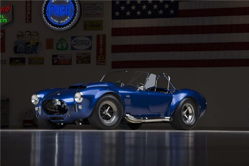 The blue 1966 Shelby Cobra 427 Super Snake in a dimly-lit garage