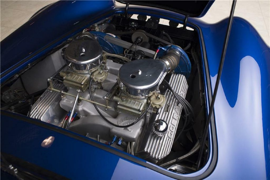 The twin-supercharged V8 under the hood of the blue 1966 Shelby Cobra 427 Super Snake