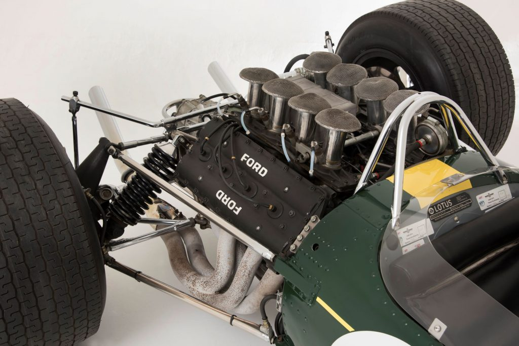 The rear-mounted V8 engine acting as a stressed member for the green-and-yellow 1967 Lotus 49 R3 DFV