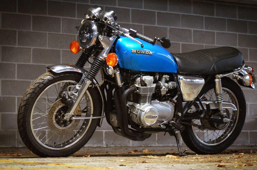 A blue 1975 Honda CB550F Super Sport in a garage