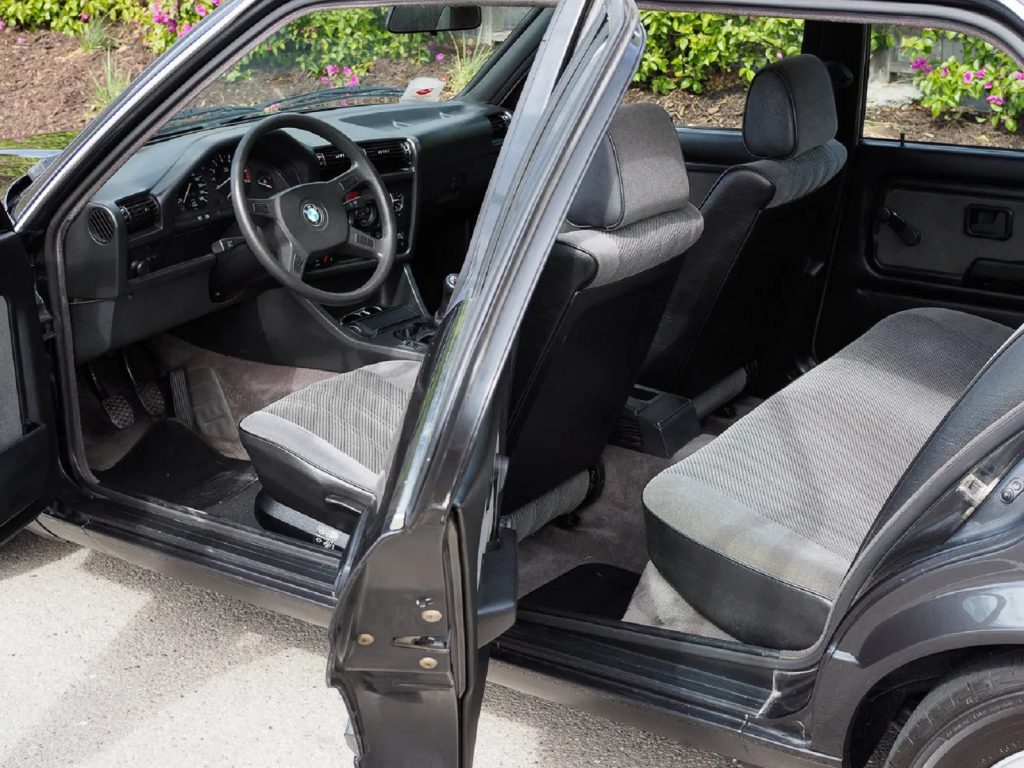 A side view of the gray-upholstered interior of a 1988 BMW 320is