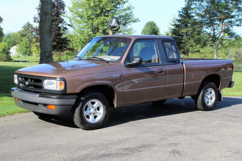 A brown 1994 Mazda B3000 SE Cab Plus parked on a driveway
