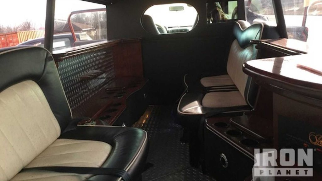1997 red Jeep Wrangler stretched into a homemade limo