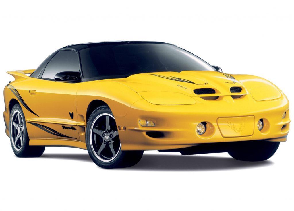 A yellow-with-silver-stripes 2002 Pontiac Firebird Trans Am WS6