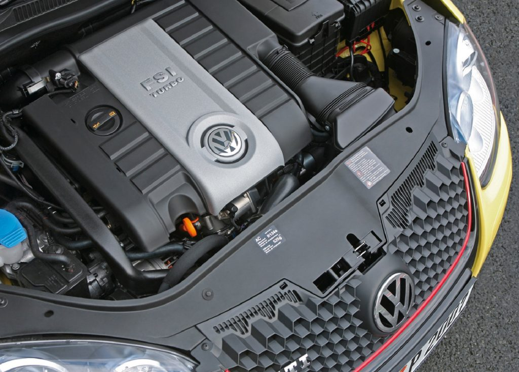 The 2.0T EA888 engine inside a yellow 2007 Volkswagen GTI Pirelli Edition