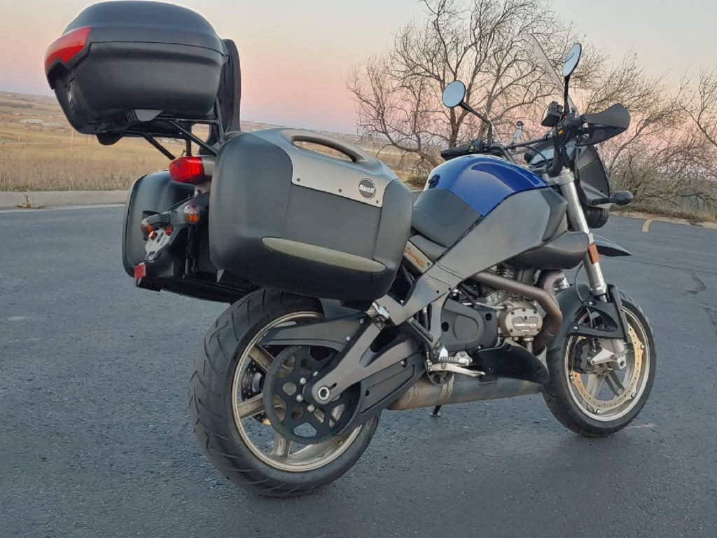 The rear 3/4 view of a blue 2008 Buell Ulysses XB12X