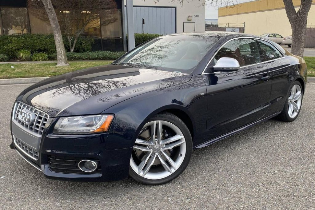 A dark-blue 2009 Audi S5 Coupe parked in a lot