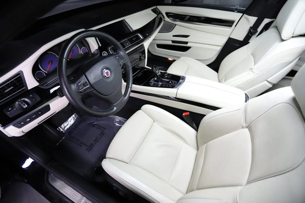 The white-leather front seats and black interior trim of a 2013 BMW Alpina B7 xDrive