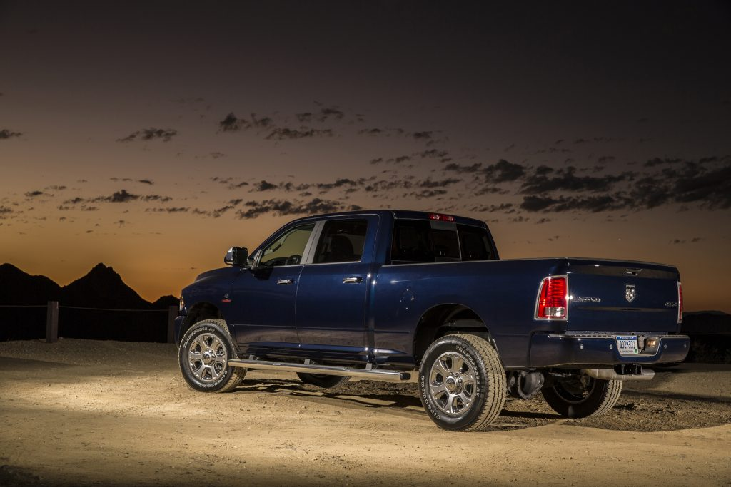 A blue 2014 Ram 2500 Heavy-Duty truck parked facing away from the camera during dusk