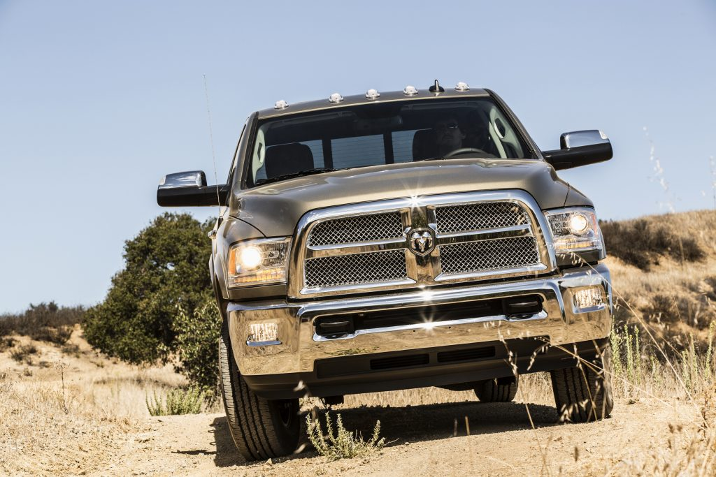 A forward-facing photo looking at the grille of a silver 2014 Ram 2500 Heavy-Duty truck