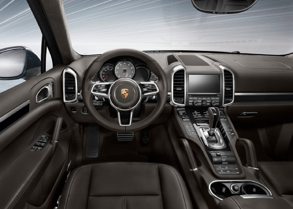 The brown-leather front seats and dashboard of a 2016 Porsche Cayenne
