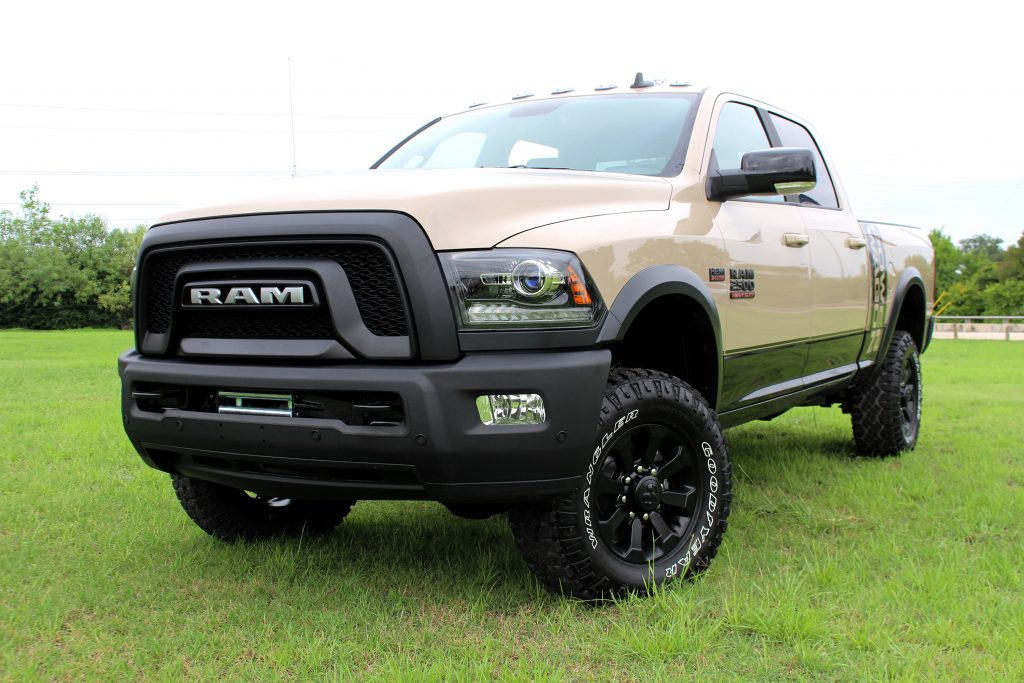 A tan 2018 Ram 2500 parked on grass