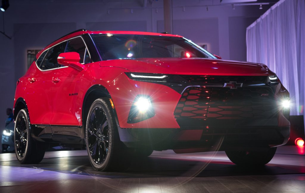 A red 2019-2021 Chevy Blazer on display during the SUV's reveal event