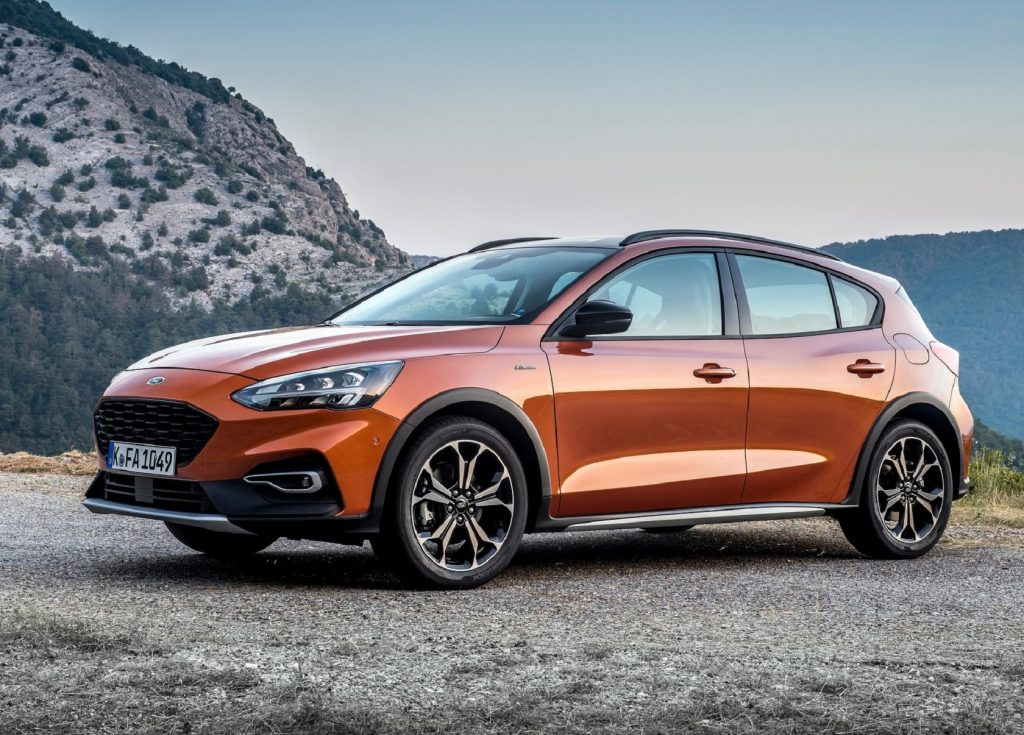 An orange 2019 Ford Focus Active wagon on a mountain road