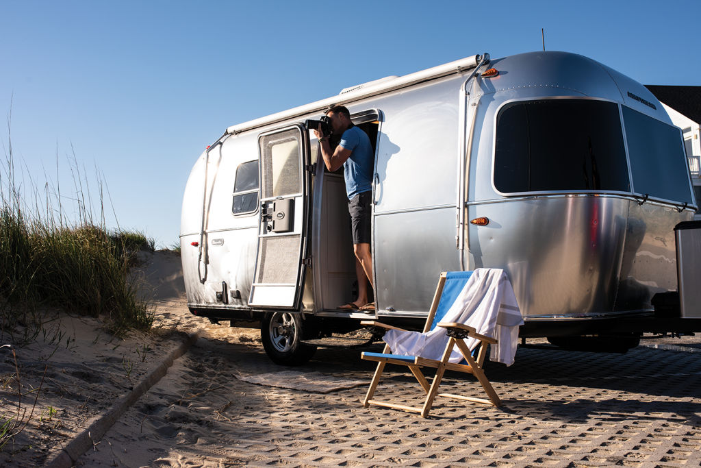 The Airstream Bambi parked at a beach.