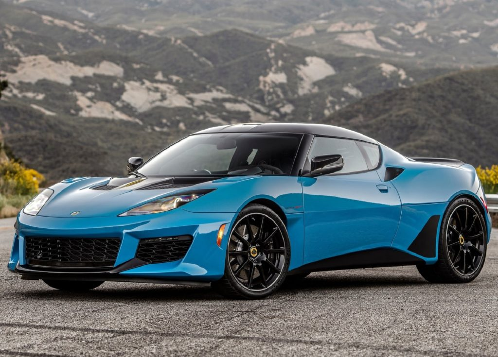 A blue 2020 Lotus Evora GT on a road in the mountains