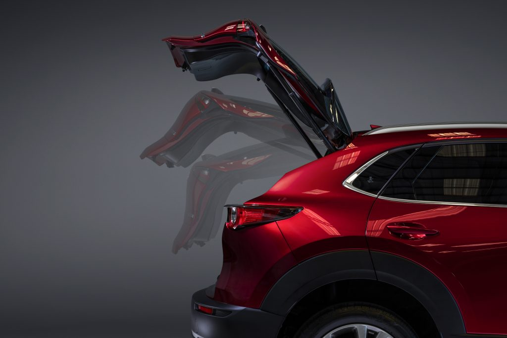 The liftgate, which has been recalled, in action on a red 2020 Mazda CX-30