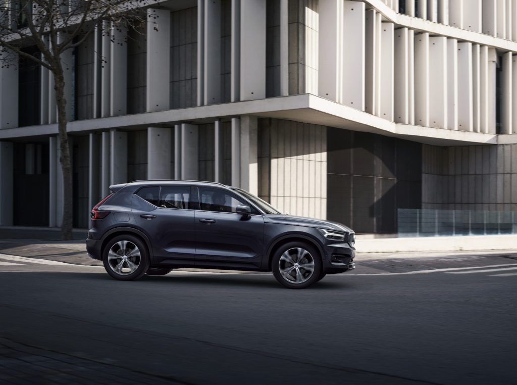 A blue 2020 Volvo XC40 Inscription driving down a city street