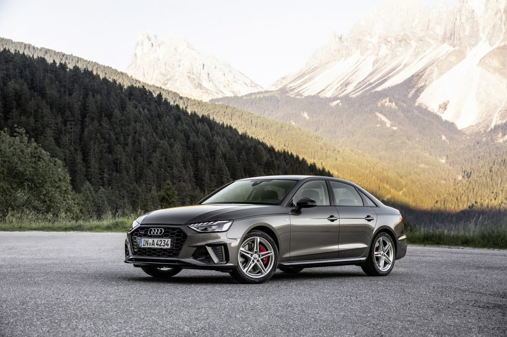 A grey 2021 Audi A4 sedan parked in front of a mountain