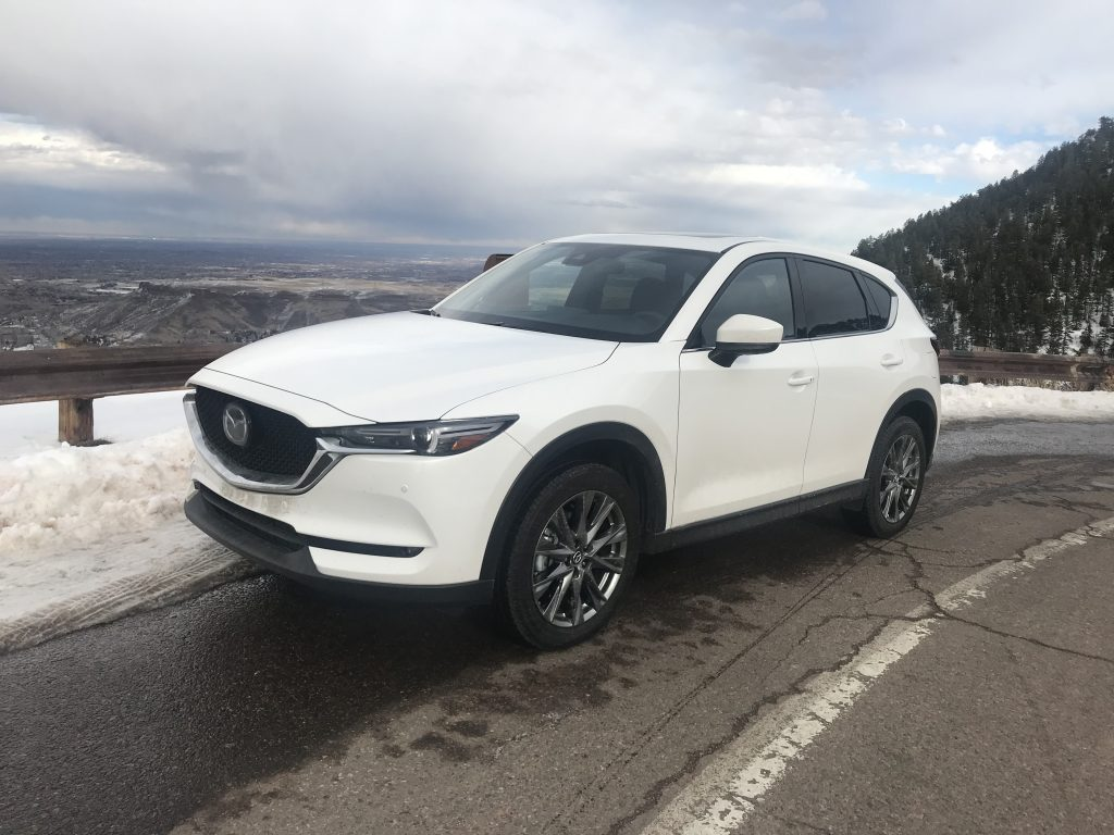 front three-quarter shot of 2021 Mazda CX-5 on a mountain road