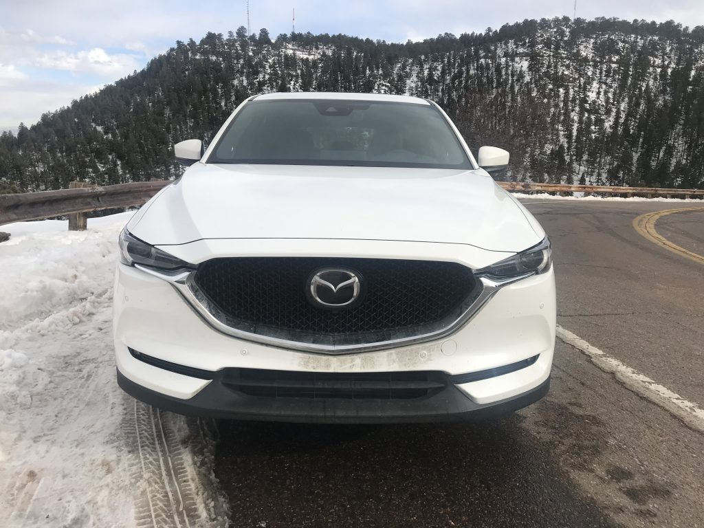 front shot of the 2021 Mazda CX-5 on a mountain road