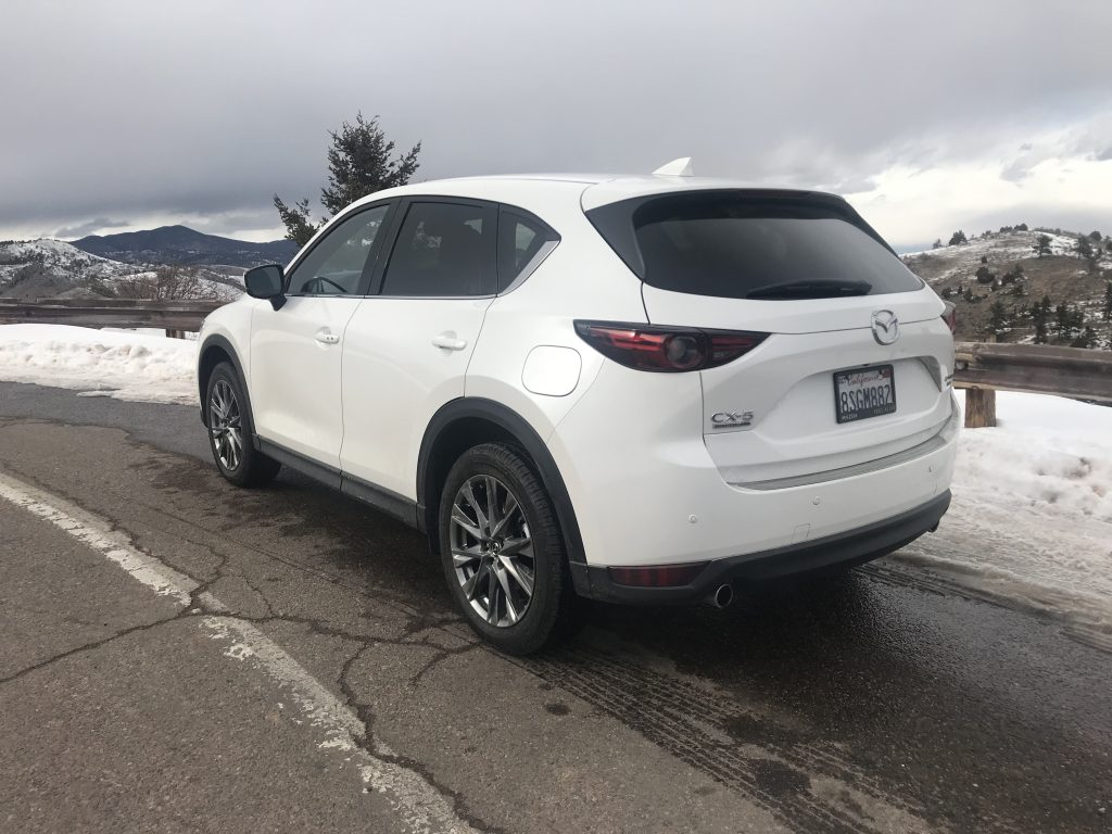 rear shot of 2021 Mazda CX-5 on a mountain road