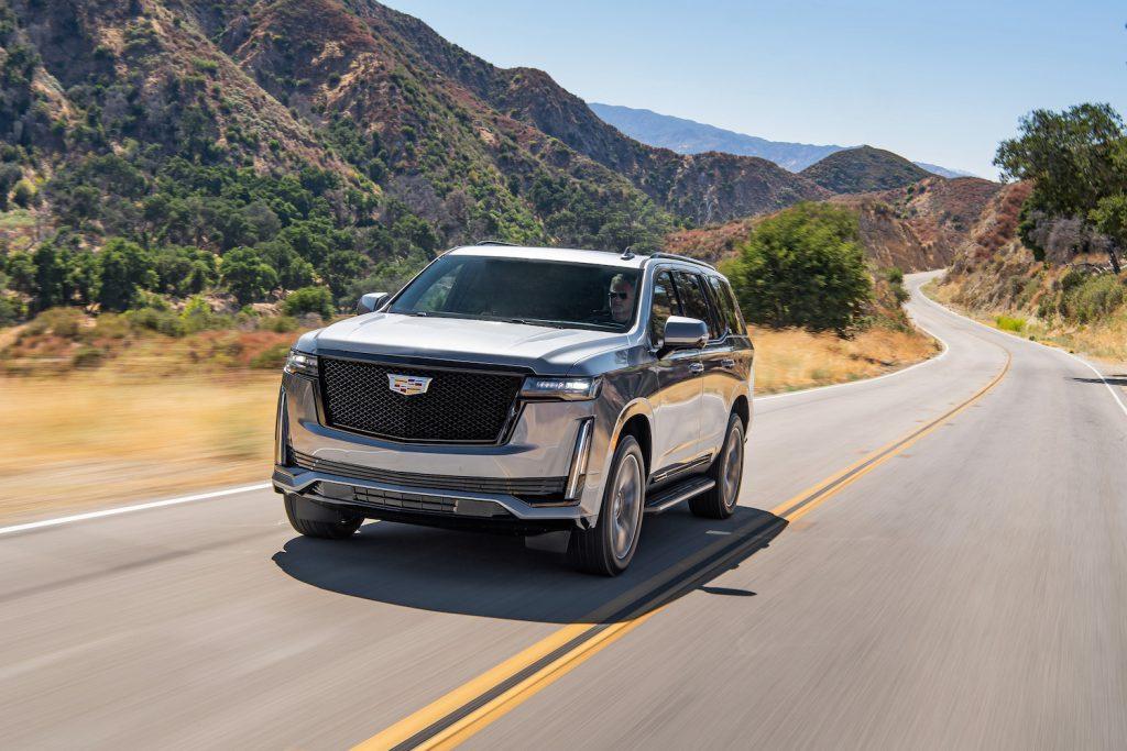 The 2021 Cadillac Escalade Sport driving