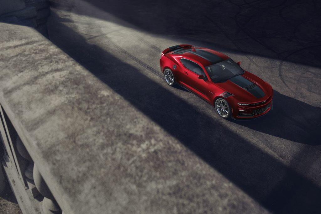 The unreliable 2021 Chevrolet Camaro parked on a black-top surface.
