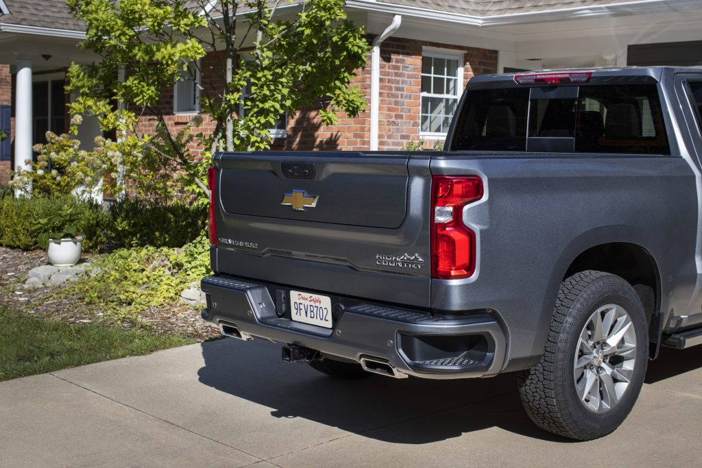 A look at the rear of a 2021 Chevy Silverado that's parked in a driveway in front of a house