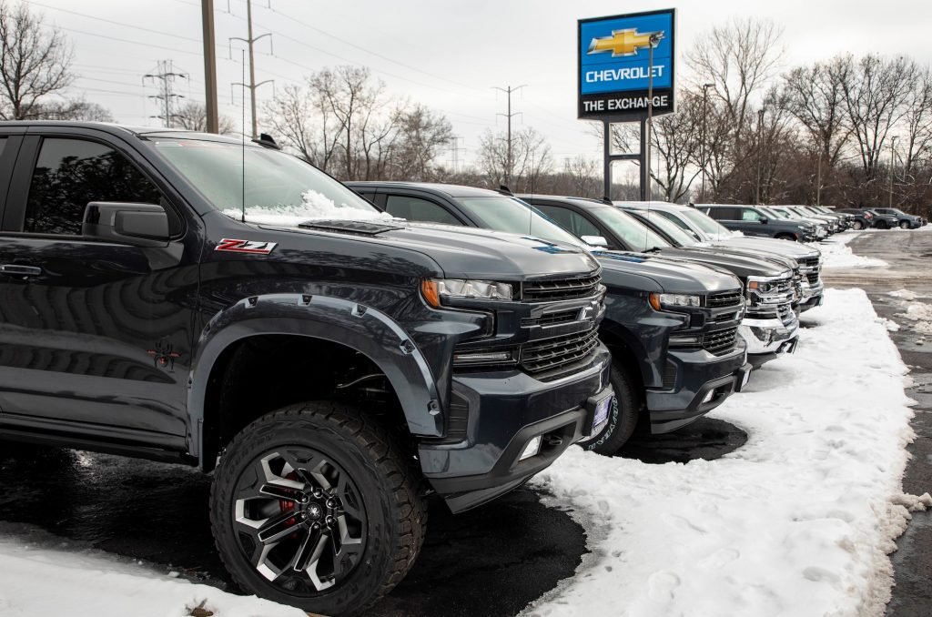 A row of Chevrolet Silverado trucks in a snow-covered parking lot at the Exchange Chevrolet in Lake Bluff, Illinois, on January 5, 2021