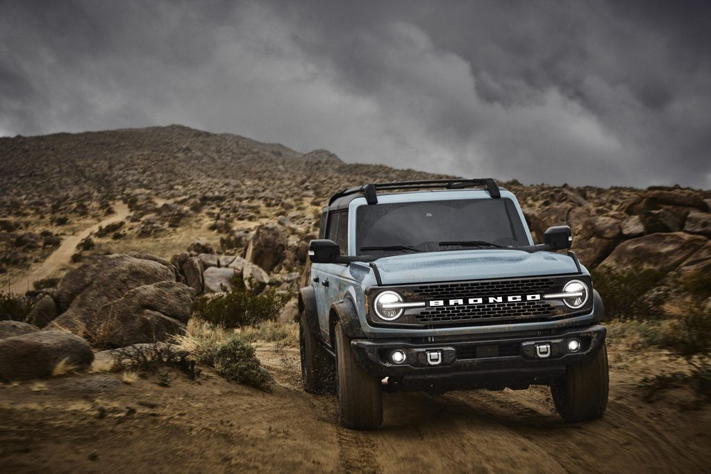 A light blue 2021 Ford Bronco parked on rugged terrain