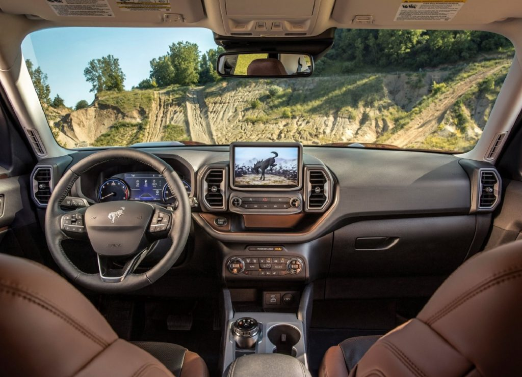 The brown-leather-lined front seats and gray dashboard of the 2021 Ford Bronco Sport Badlands with the Badlands Package