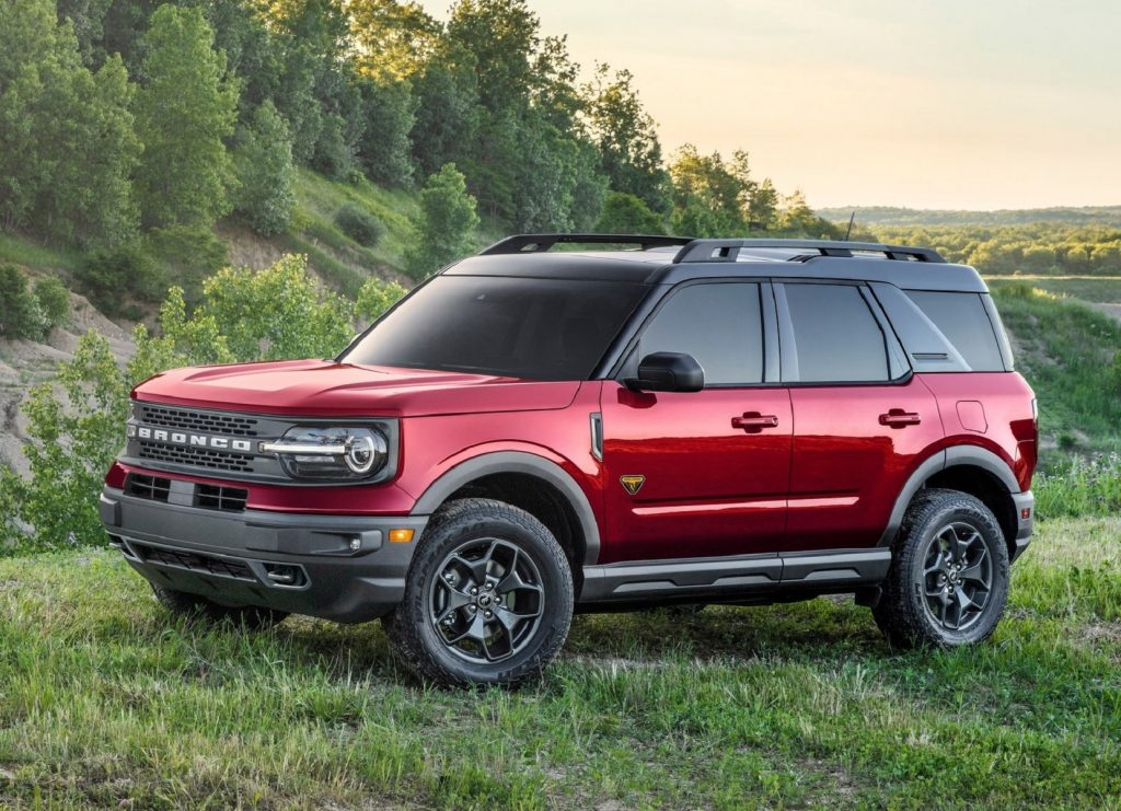 The side 3/4 view of a red 2021 Ford Bronco Sport Badlands in a grassy field