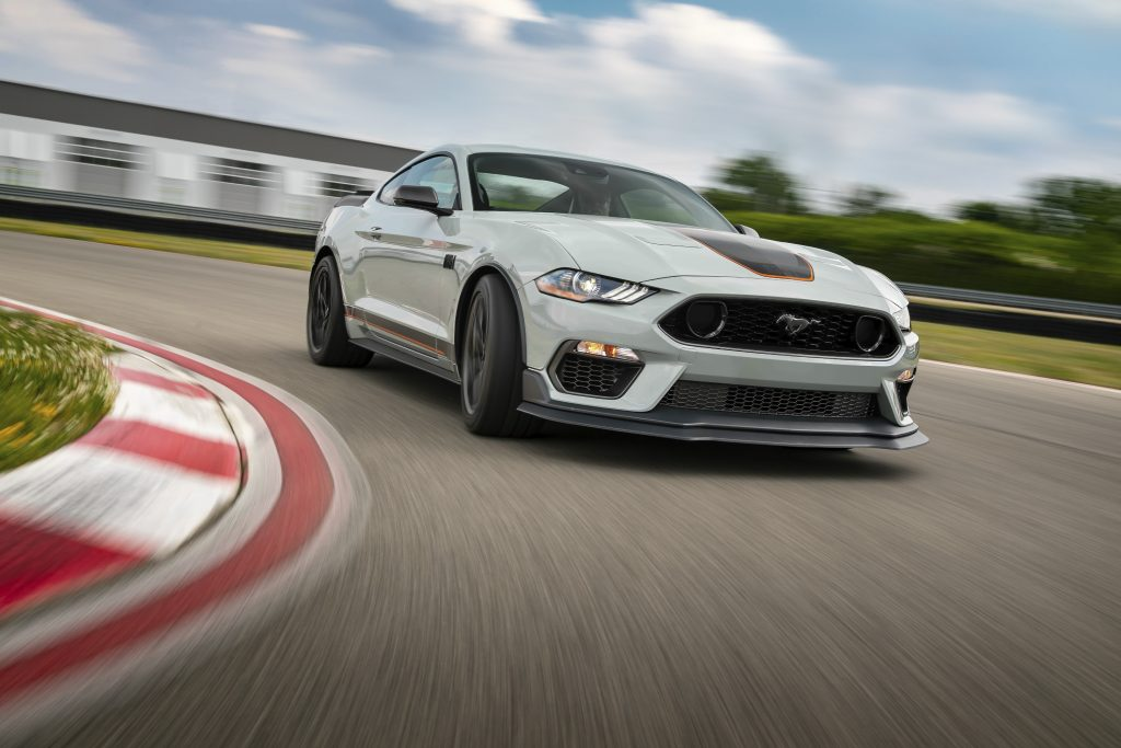 A grey 2021 Ford Mustang Mach 1 taking a turn on a race track