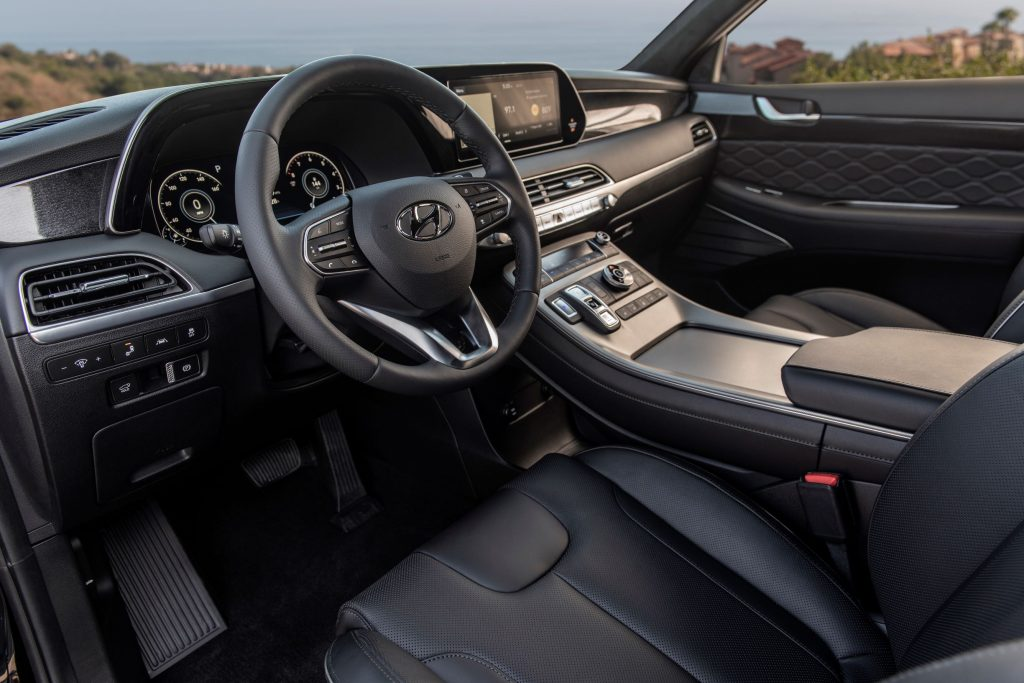 The dashboard and black-leather-upholstered front seats of the 2021 Hyundai Palisade Calligraphy