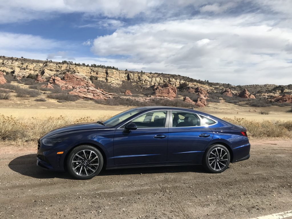 2021 Hyundai Sonata Limited parked in the desert with mountains in the background
