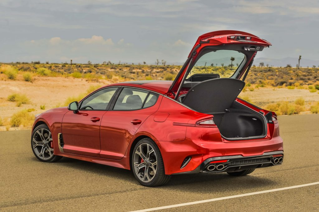 A red 2021 Kia Stinger GT2 parked with its rear hatch open