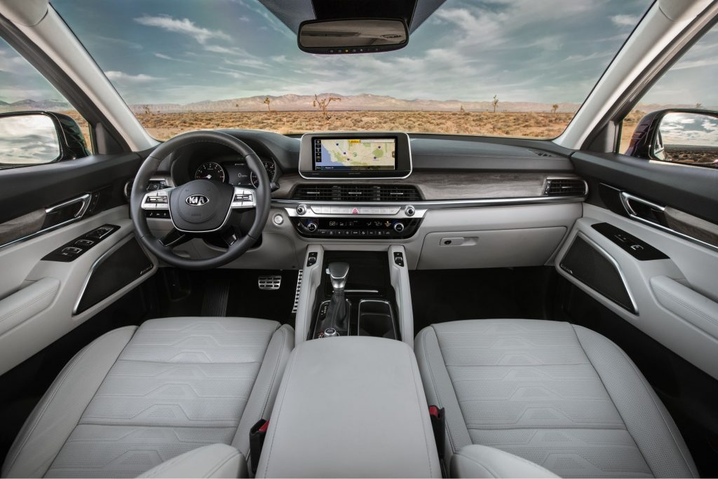 The dashboard and white-leather-upholstered front seats of the 2021 Kia Telluride