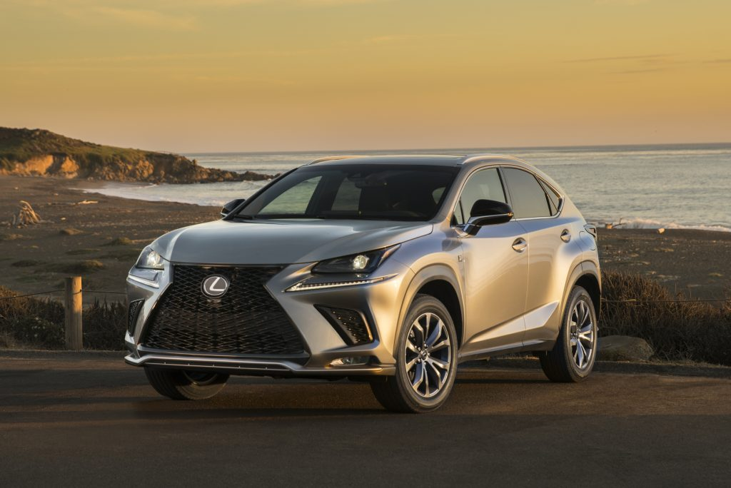 A silver 2021 Lexus NX 300 parked next to the oceanside