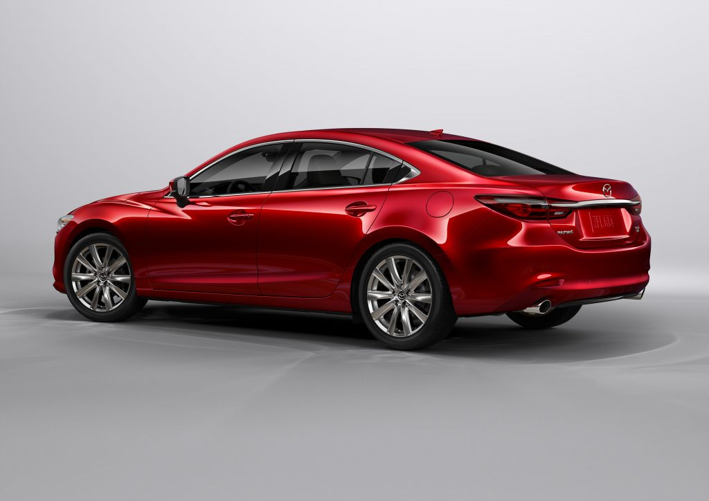 A red 2021 Mazda6 on display, facing away from the camera