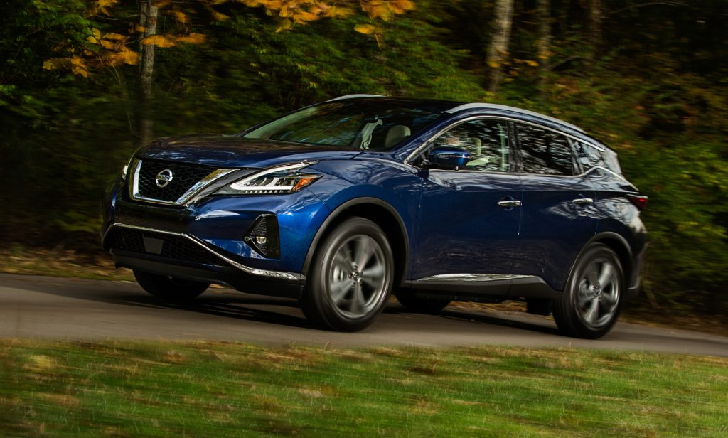 A blue 2021 Nissan Murano driving down a country road used to highlight a list by Consumer Reports.