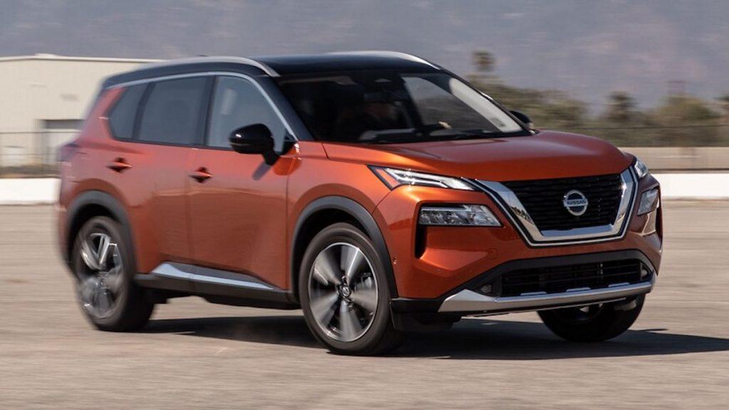 2021 Nissan Rogue in orange in a parking lot