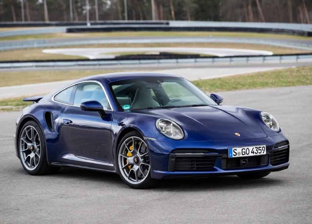 A blue 2021 Porsche 911 Turbo S parked on a racetrack