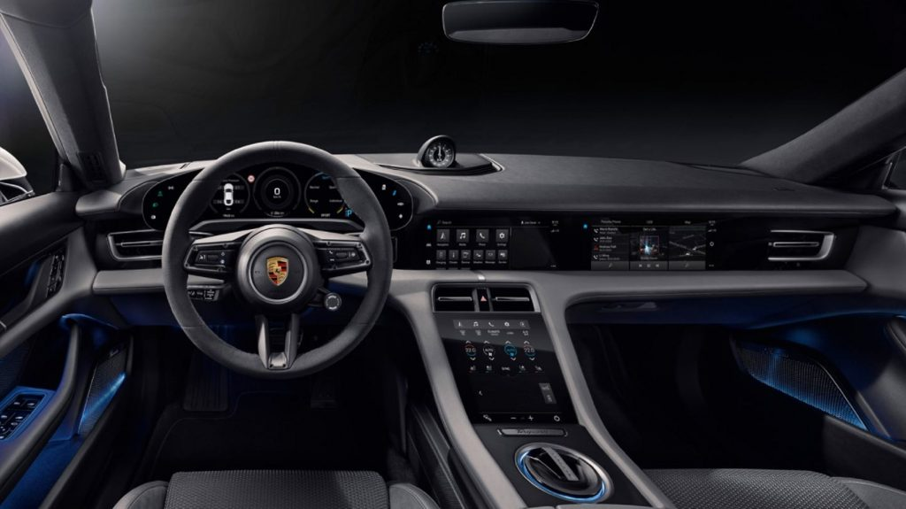 The gray-and-black front seats and dashboard of the 2021 Porsche Taycan Turbo