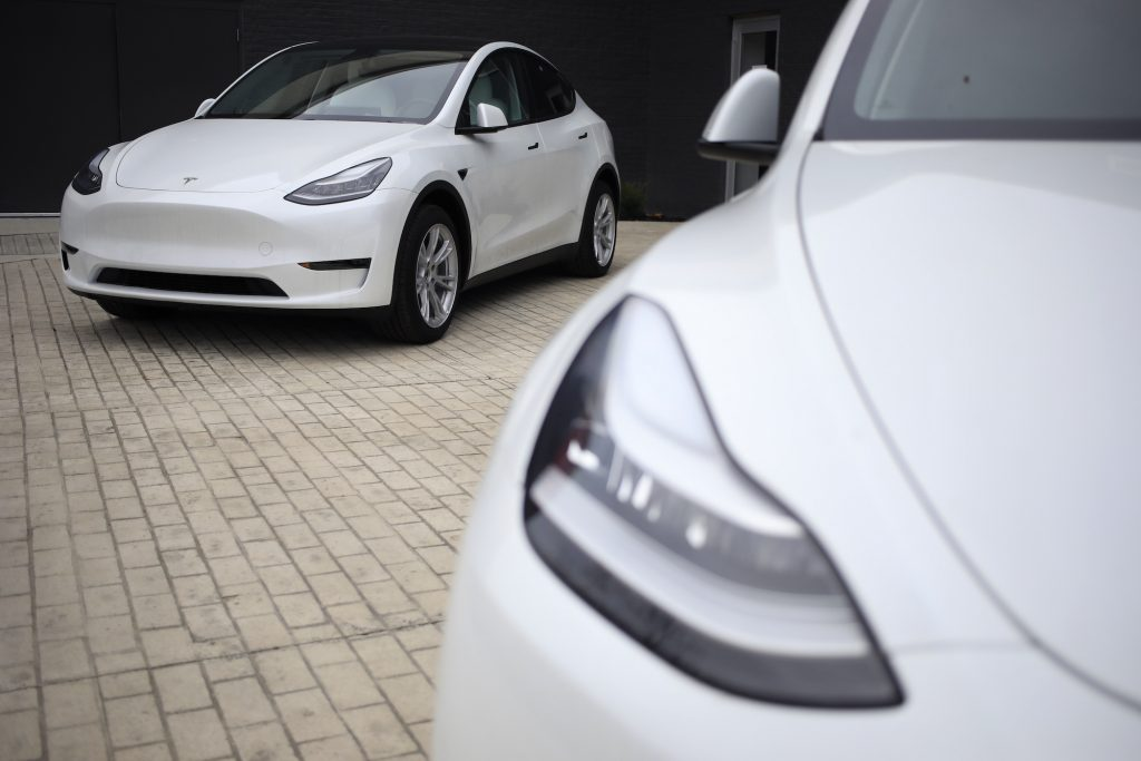 Two white Tesla Model S electric vehicles for sale outside a dealership at the Easton Town Center Mall in Columbus, Ohio, U.S., on Thursday, Jan. 7, 2021.