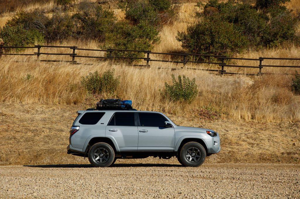 A silver 2021 Toyota 4Runner parked on a dirt road