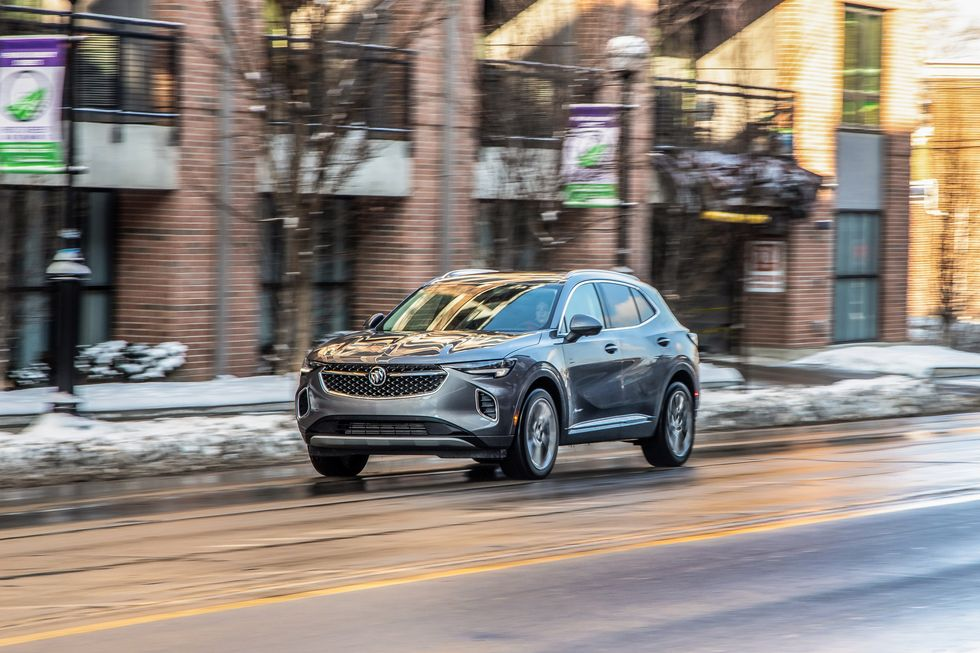The 2021 Buick Envision driving on city street