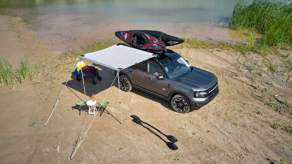 2021 Ford Bronco Sport in a feild wearing the new Water themed bundle with kayaks