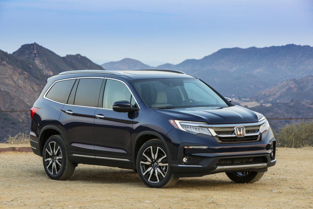 2021 Honda Pilot parked in front of a mountain range